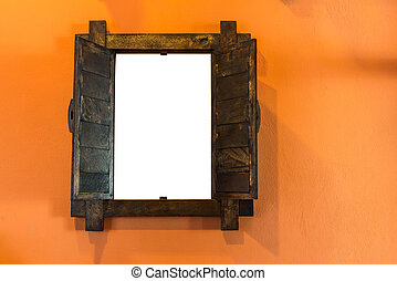 Old wooden window on orange wall with empty space