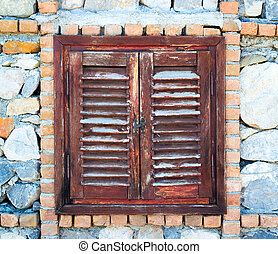 Old wooden window shutters closed