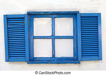 old wooden window on the white wall with weathered shutter