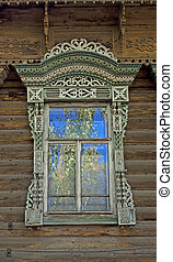 Old wooden window with carved decoration