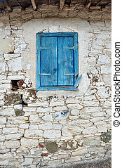 Old Wooden window with shutters painted blue color