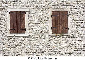 Windows in the old stone wall