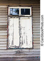 Old woody window on wood wall