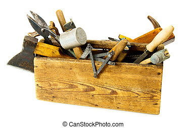 Working tools (drill, scissors and others) in an old box on white background.