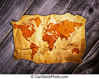 Old world map over wooden background