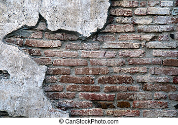 Old Worn Down Brick Wall with Plaster - An old worn down red...