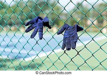 Old worn gardener's working blue wool Glove