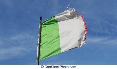 Old worn italian flag in the wind