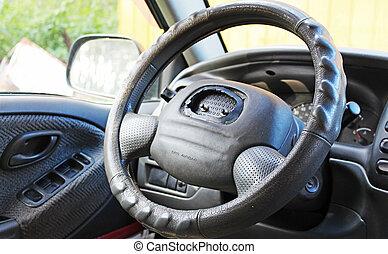 Old worn steering wheel in the car
