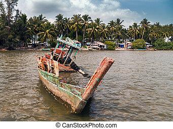 Old wrecked ship on the beach sea coast.