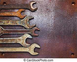 Old wrenches on a metal table