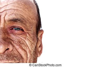 Old wrinkled man against white background