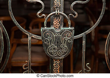 old wrought-iron lock on the door