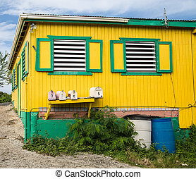 Old Yellow and Green Building with Window Vents