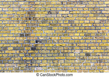 old yellow brick wall for backgrounds