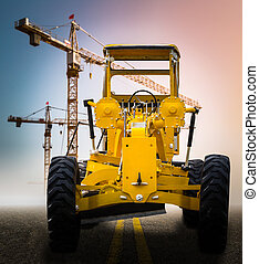 old yellow motor grader on the road