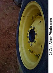 Old yellow tractor tire rim