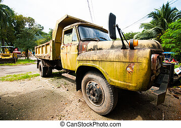 old yellow truck parking at work