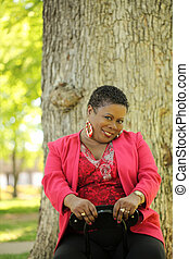 Older African American woman outdoors portrait sitting