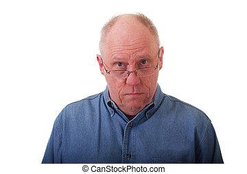 4518e266d5cb Older man looking at prescription bottle. An older bald man in a ...