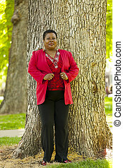 Older Black Woman Standing Outdoor Red Jacket