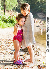 Older brother hugs his sister