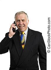 older businessman on phone in anguish