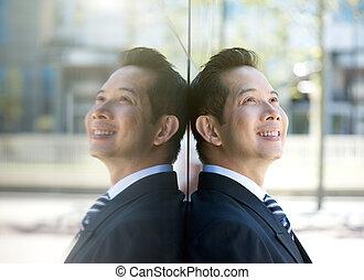 Older businessman smiling outdoors