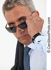 Older businessman wearing sunglasses