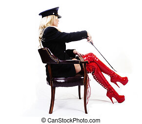 Older Caucasian Blond Woman Boots Jacket Hat Sitting