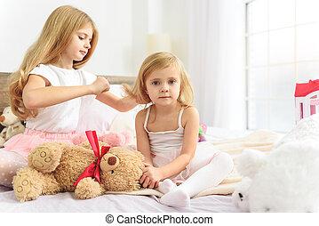 Older child taking care of her little sibling