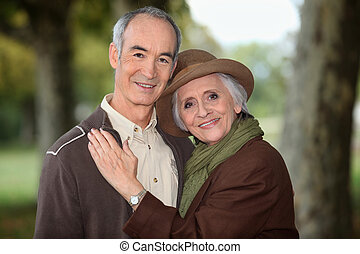 Older couple enjoying an autumnal stroll