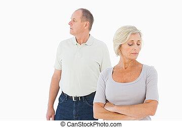 Older couple having an argument on white background