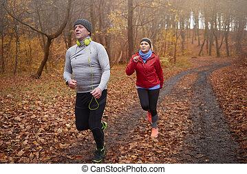 Older couple having training outside