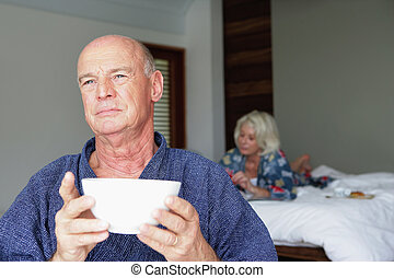 Older couple in a bedroom