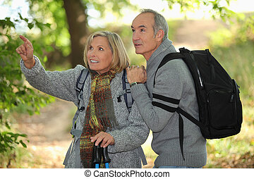 older couple in woods