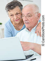older couple surfing the web