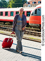 older elderly couple at the railway station