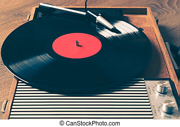 Older Gramophone with a vinyl record close up