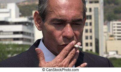Older Hispanic Business Man Smoking