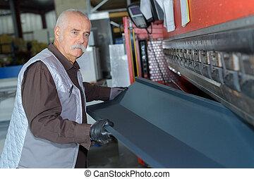 older male steel worker