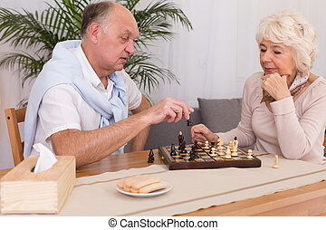 Older man and checkmate in chess