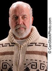 older man in a sweater looking like Ernest Hemingway