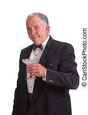 older man in tuxedo with a margarita