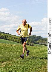Older man jogging running on meadow - Older Senior running ...