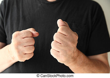 older man making fists