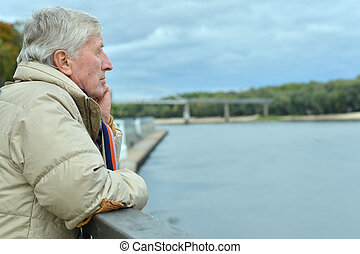 Older man on the bridge - Older man thinking on the bridge