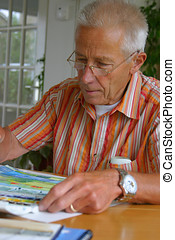 Older man painting - Older man working on his hobby painting