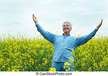 Older man - Older are enjoying the fresh air surrounded by...