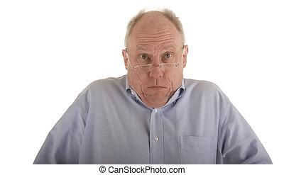 Older Man Shrugging - An older guy in a blue shirt and...